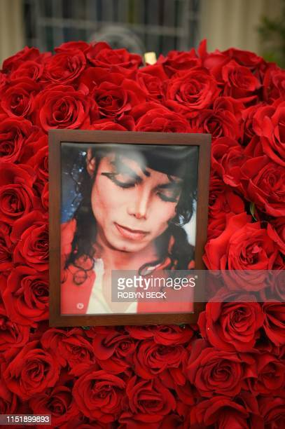 Pictures and flowers placed by fans gathered outside Michael Jackson's final resting place at the Holly Terrace mausoleum in Forest Lawn Cemetery in...