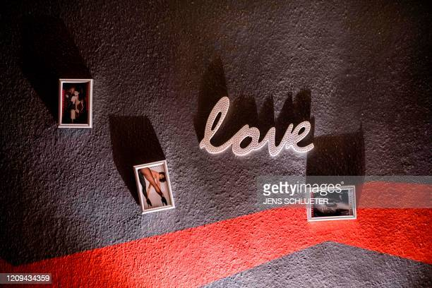 Pictures and the word love hanging on a wall are pictured in the closed brothel 'XCarree' in Halle/Saale eastern Germany on April 7 where many...