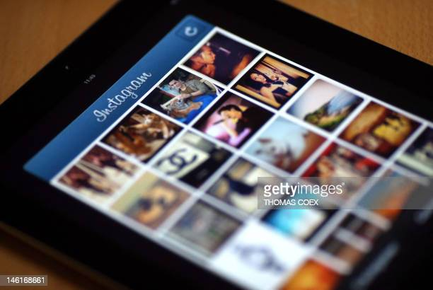 Pictures appear on the smartphone photo sharing application Instagram on April 10 2012 in Paris one day after Facebook announced a billiondollardeal...