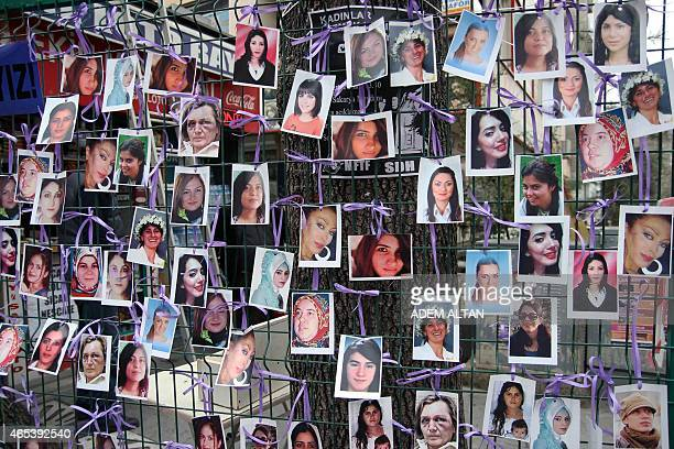 Pictures are displayed at a photo exhibition of murdered women staged as a protest against violence towards women in Ankara on March 6 2015 ahead of...