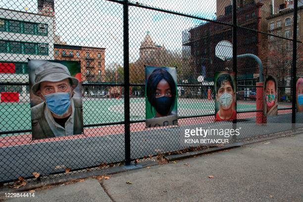 """Pictures made by AJ Stetson, including a portrait of Magnum photographer Bruce Gilden , are displayed during Stetson's """"Masked NYC"""" exhibition on the..."""