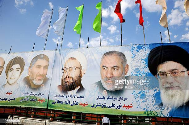 Pictures of Ayatollah Ali Khamenei and martyrs of the armed forces are displayed on a huge banner during a military parade commemorating the 31st...