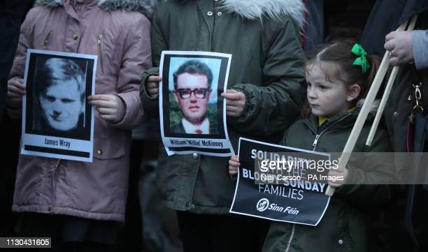 Pictures of Bloody Sunday victims James Wray and William McKinney during a vigil in West Belfast Northern Ireland after the announcement from the...