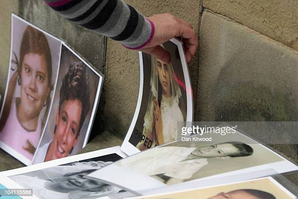 Pictures of children abused by priests are laid on the steps of St Mary's Metropolitan Cathedral on September 15 2010 in Edinburgh Scotland A protest...