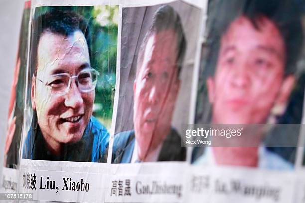 Pictures of Chinese dissidents including Nobel Prize laureate Liu Xiaobo are seen on a banner during a rally for Liu December 10 2010 in Washington...