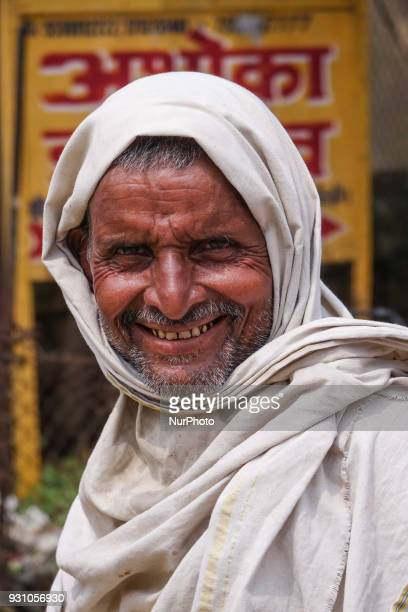 Pictures of diverse faces and people in India representing the daily life in the region of Delhi Varanasi Gaya and Uttar Pradesh
