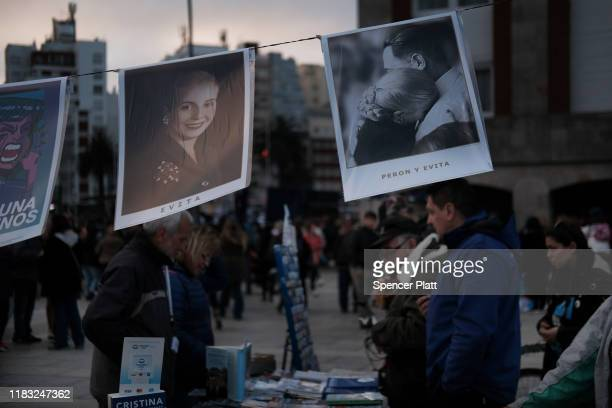 Pictures of Eva Peron, better known as Evita, are displayed for sale as large crowds gather to watch the closing rally for Presidential candidate...