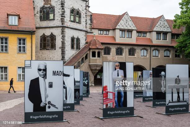 Pictures of German fashion designer Karl Lagerfeld are seen in the courtyard of the Moritzburg Art Museum in Halle/Saale eastern Germany on May 20...