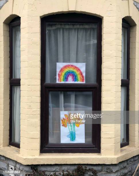 Pictures of goodwill are displayed in the window of a home on March 28 2020 in Penarth Wales The Coronavirus pandemic has spread to many countries...