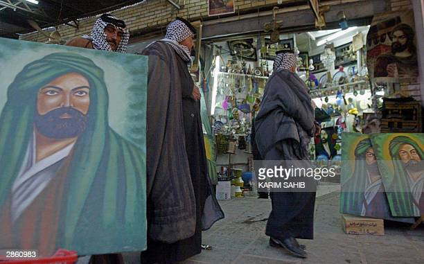 Pictures of Imam Ali cousin and brotherinlaw of Prophet Mohammed and Islam's fourth Caliph are on display at the holy Shiite city of Najaf 160 kms...