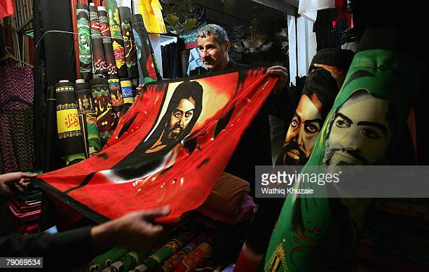 Pictures of Imam Hussein are displayed for sale at a shop on January 17 2008 in the holy Shiite city of Karbala about 70 miles south of Baghdad Iraq...