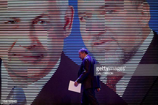 Pictures of Israeli Prime Minister Benjamin Netanyahu and Foreign Minister Avigdor Lieberman are displayed as the latter leaves after a speech during...