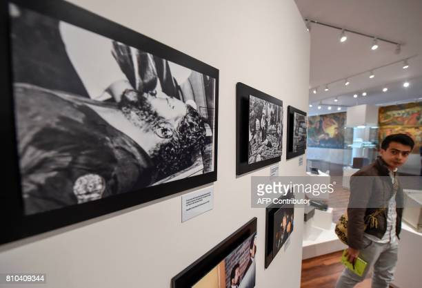 Pictures of lata drug lord Pablo Escobar and other drug traffickers are on displayn during the opening of Colombia's General Prosecutor's Office...