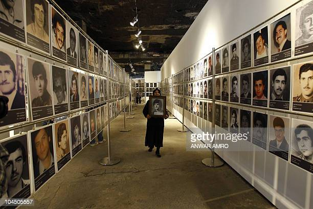 Pictures of Lebanese missing since the 19751990 civil war are displayed in City Center a building still bearing scars of the war in Beirut on April...
