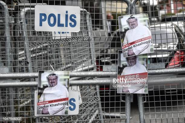 Pictures of missing journalist Jamal Khashoggi are seen on Police fence during a demonstration in front of the Saudi Arabian consulate on October 8...