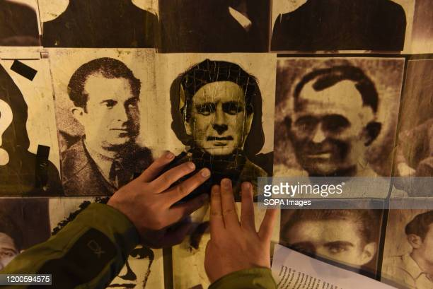 Pictures of missing people during the dictatorship of Francisco Franco are seen during the protest. Around hundred people gathered in Madrid to...