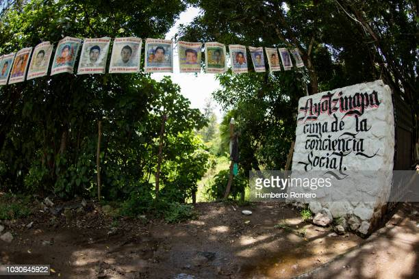 Pictures of missing students hang from trees before a press conference of the InterAmerican Commission on Human Rights to present a report on the 43...