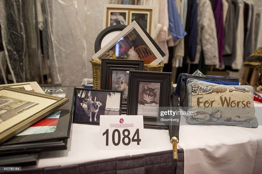 Pictures of pets owned by belonging to notorious Boston mobster James 'Whitey' Bulger and his longtime girlfriend Catherine Greig are displayed during before an asset-forfeiture auction in Boston, Massachusetts, U.S., on Friday, June 24, 2016. The U.S. Marshals Service auctioned off items seized in 2011 from the Santa Monica hideout of the Bulger and Greig. Photographer: Scott Eisen/Bloomberg via Getty Images