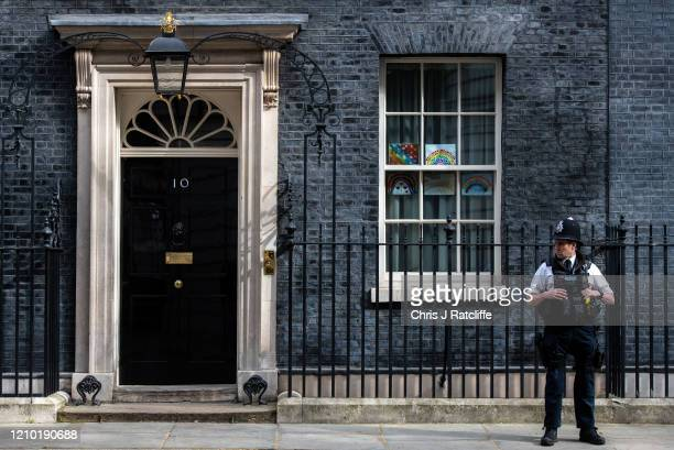 Pictures of rainbows and supportive messages for key workers and the National Health Service adorn the windows of number 10 Downing Street on April...