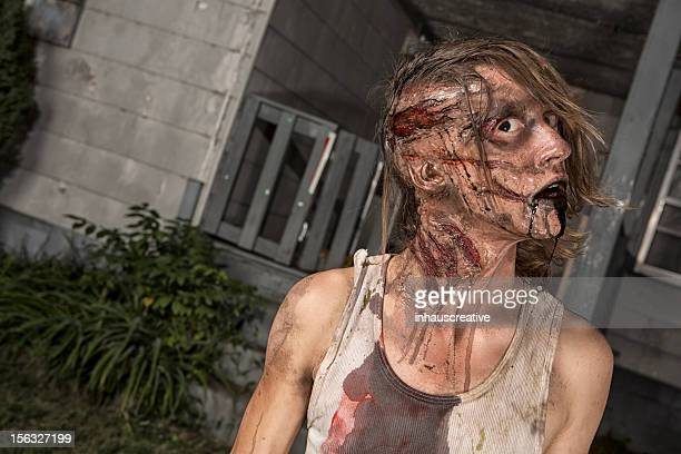 pictures of real classic zombie outside an old farmhouse - old ugly woman stock photos and pictures