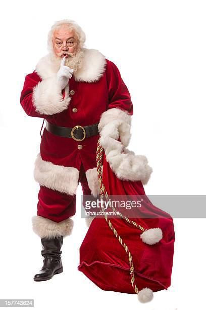 pictures of real santa claus has a gift bag - santa face stock pictures, royalty-free photos & images