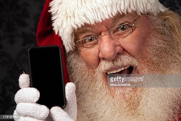 Fotografias do Real Pai Natal tem um Smartphone mensagens