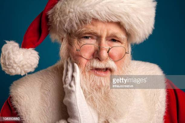 Pictures of Real Santa Claus has a Tooth Ache