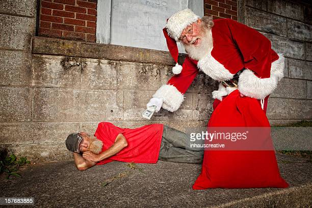 pictures of real santa claus helping ones in need - dirty santa stock pictures, royalty-free photos & images