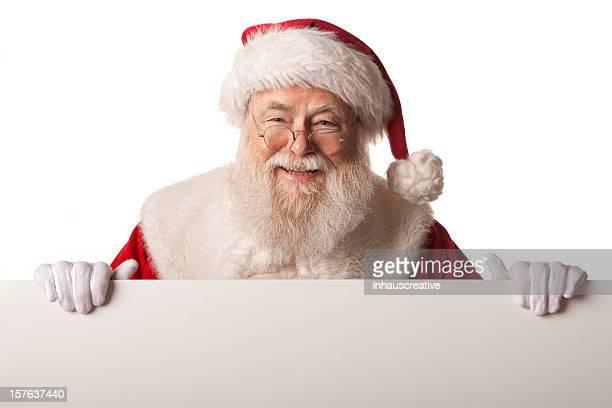 Fotografias do Real Pai Natal segurando uma placa em branco