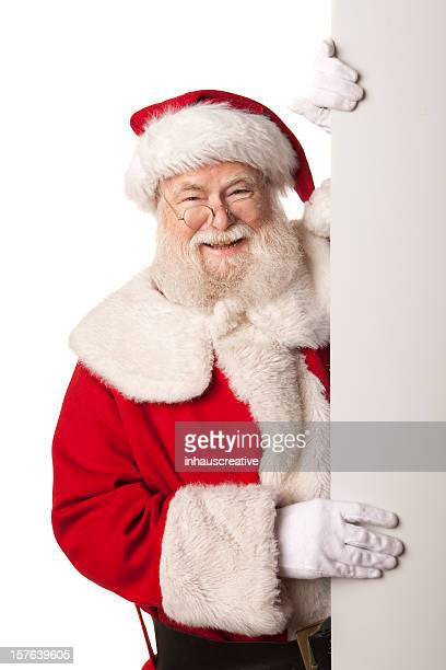 pictures of real santa claus holding a blank sign - santa face stock pictures, royalty-free photos & images