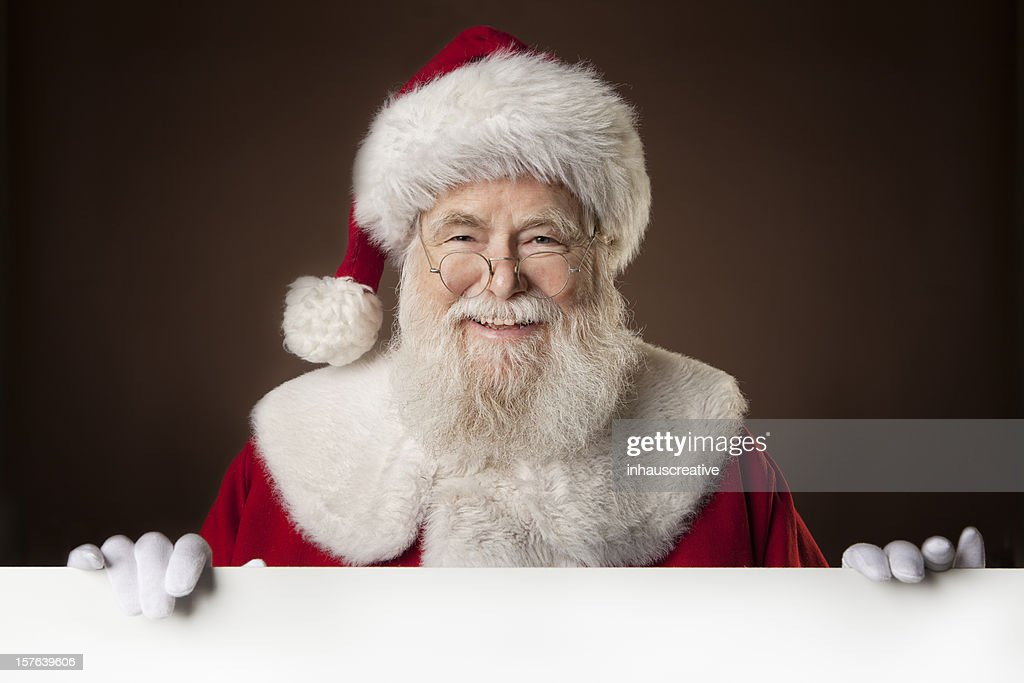Pictures of Real Santa Claus holding a blank sign : Stock Photo
