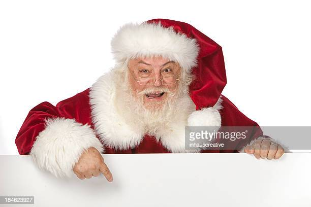 pictures of real santa claus holding a blank sign - santa face stockfoto's en -beelden