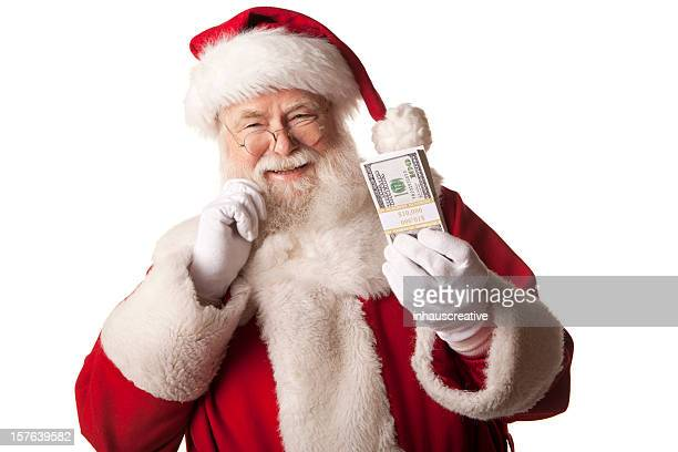 pictures of real santa claus holding christmas cash bonus - christmas cash stock pictures, royalty-free photos & images