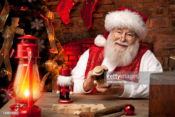 pictures of real santa claus in his workshop making toys - santa stock photos and pictures