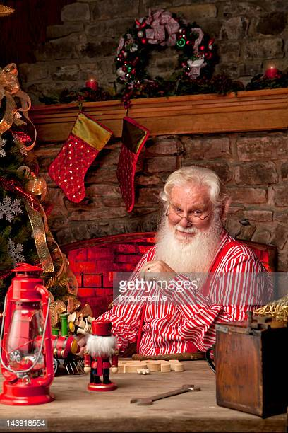 pictures of real santa claus in his workshop making toys - santas workshop stock photos and pictures