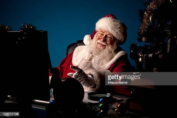 pictures of real santa claus looking at computer - santas workshop stock photos and pictures