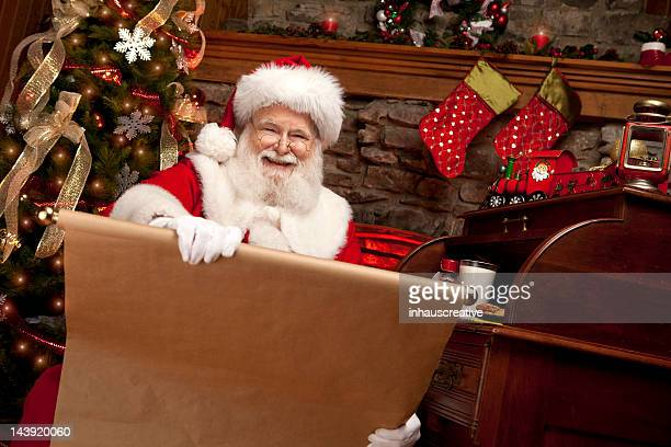 Pictures of Real Santa Claus making his naughty nice list