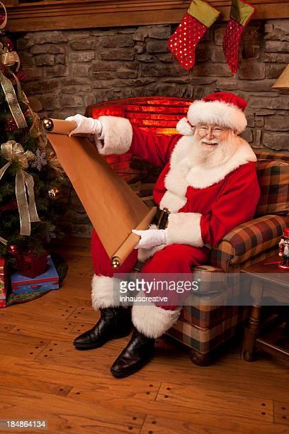 Fotografias do Real Pai Natal fazendo sua provocadora nice lista