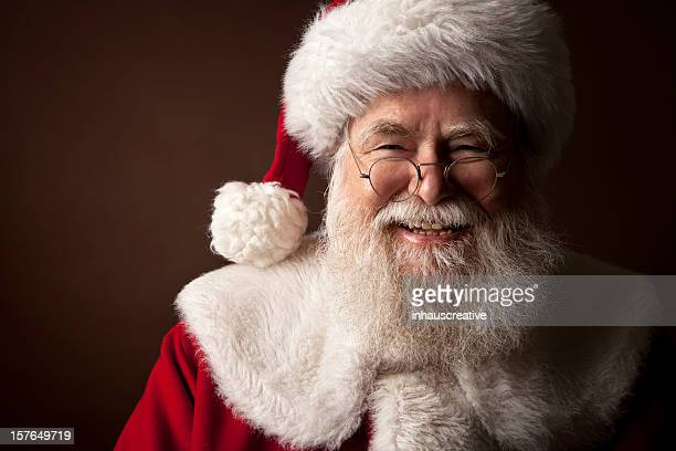 pictures of real santa claus - santa stock photos and pictures