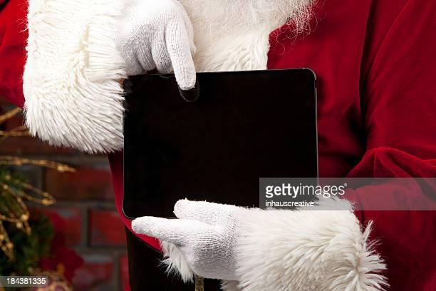 Fotografias do Real Santa Claus apontando para Tablet Digital