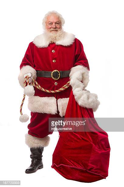 pictures of Real Santa Claus standing with gift bag
