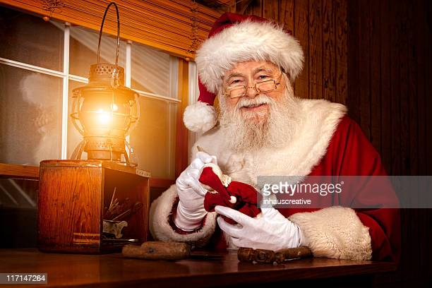pictures of real santa claus working in his shop - santas workshop stock photos and pictures