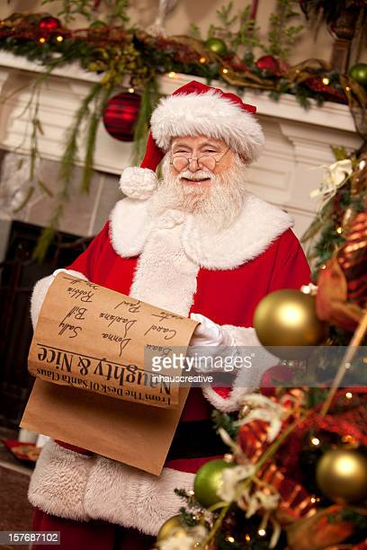 pictures of real santa claus's list he's checking twice - naughty santa stock photos and pictures