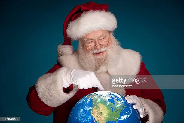 Pictures of Real Santa Studying Globe pointing to North Pole