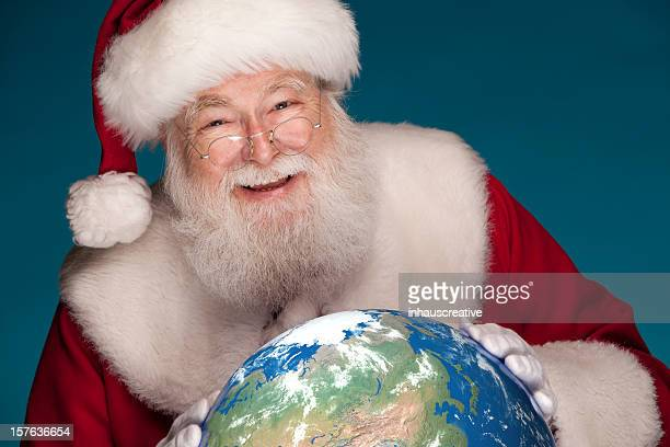 Pictures of Real Santa Studying Globe with North Pole