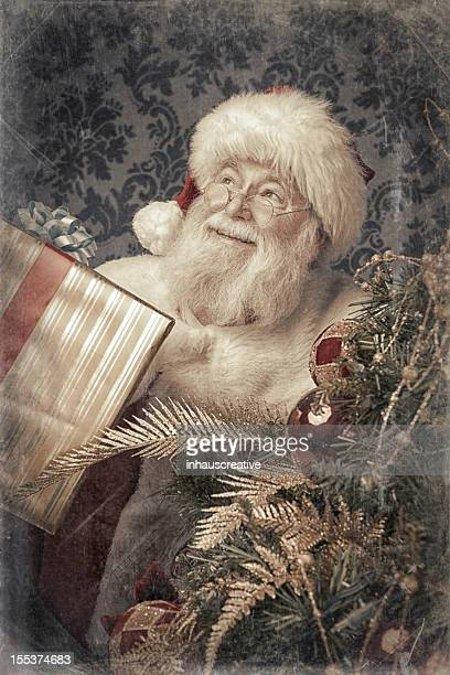 Pictures of Real Vintage Santa Claus binging presents