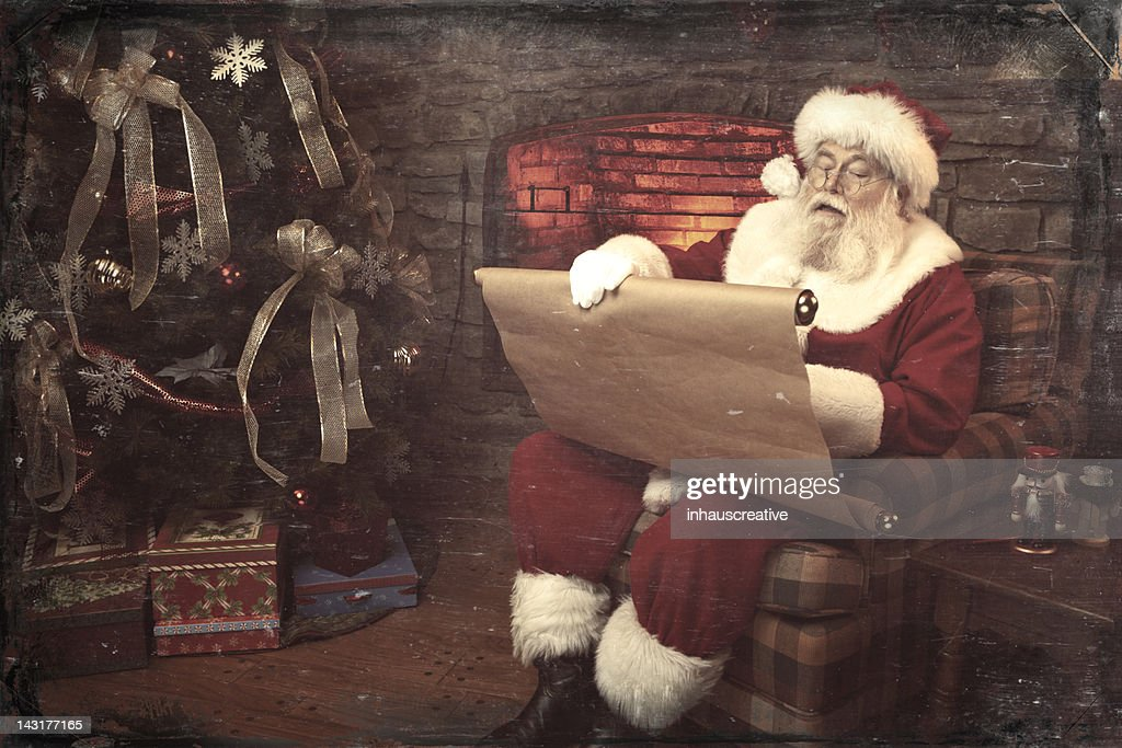 Pictures of Real Vintage Santa Claus checking his list twice : Stock Photo