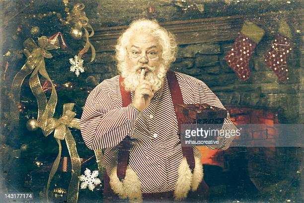 Pictures of Real Vintage Santa Claus holding gift
