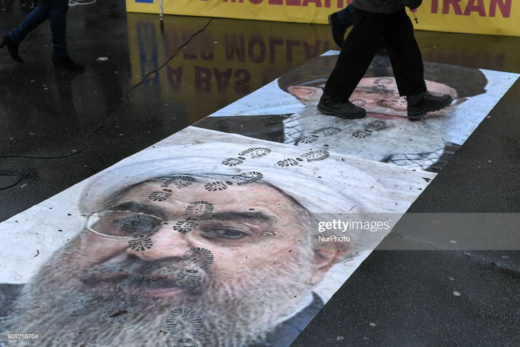 Pictures of Ruhollah Khomeini and Hassan Rohani are stomped by the protesters in front of the ambassy of Iran against the arrestations and the killing in Iran, on 4 January 2018 in Paris, France.