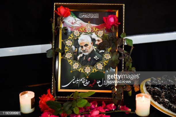 Pictures of slain Iranian military commander Qasem Soleimani is seen during a ceremony at the Iranian Consulate in Quetta on January 6, 2020. - A US...